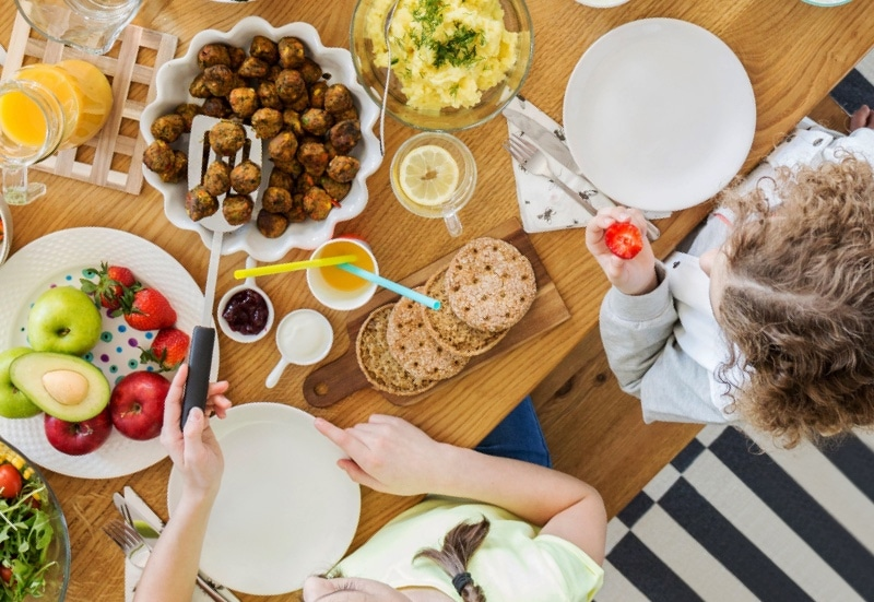 people eating food dishes on table