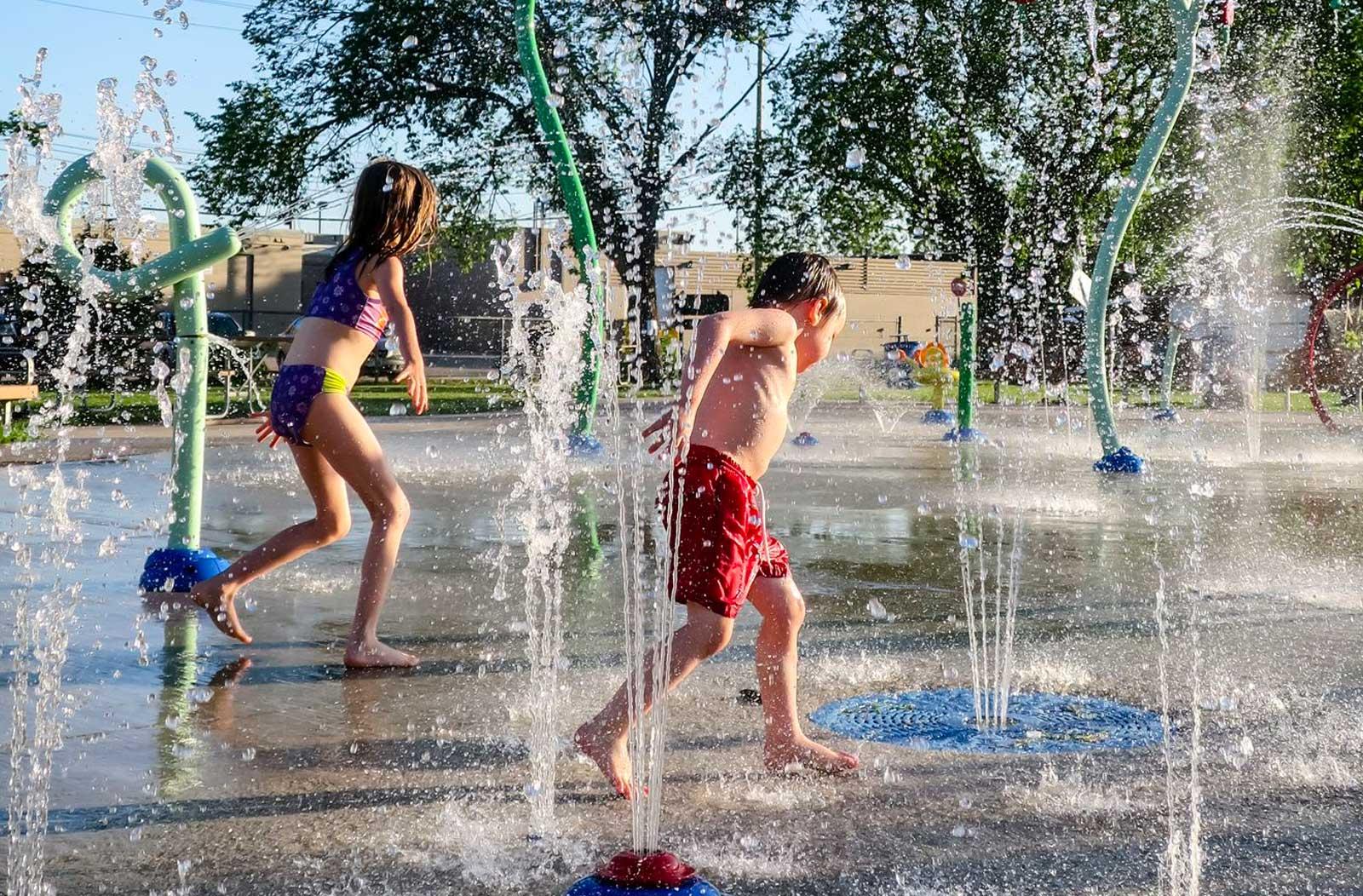 children running though water park