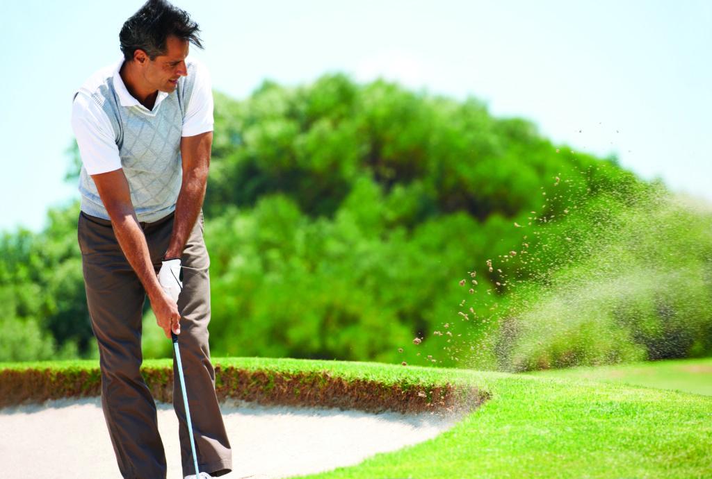 Golfer in sandtrap